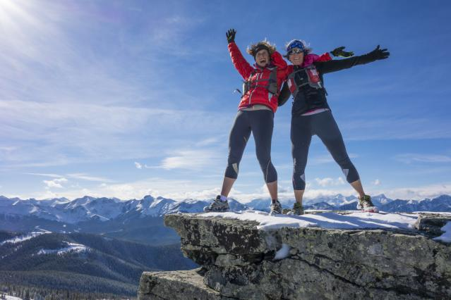 happy-women-smiling-hiking-on-summit