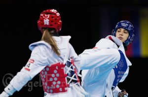 10 AUG 2012 - LONDON, GBR - Seham el-Sawalhy (EGY) (right) of Egypt battles with Elin Johansson of Sweden during their women's -67kg category preliminary round Taekwondo contest at the London 2012 Olympic Games at Excel in London, Great Britain (PHOTO (C) 2012 NIGEL FARROW)