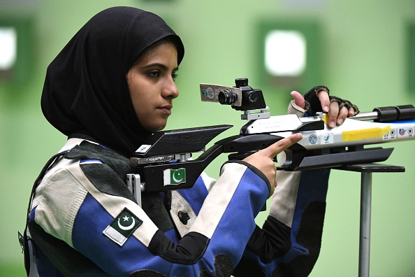 Pakistan's Minhal Sohail competes in the women's 10m air rifle shooting qualifications at the Rio 2016 Olympic Games at the Olympic Shooting Centre in Rio de Janeiro on August 6, 2016. / AFP / Pascal GUYOT (Photo credit should read PASCAL GUYOT/AFP/Getty Images)