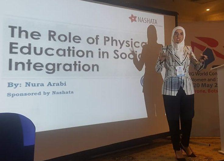 Nura Arabi presenting her paper at IWG